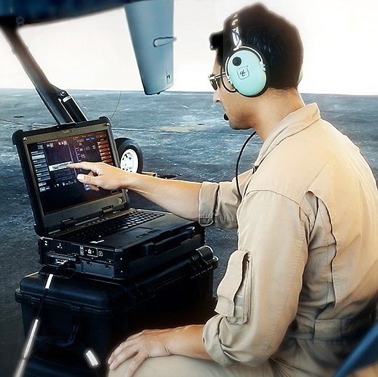 A field technician demonstrates how the XC2 portable laptop can initiate and shut down the flight of an MQ-9B remotely piloted aircraft. Photo courtesy of General Atomics Aeronautical Systems Inc.