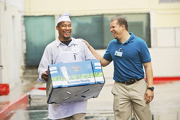 Derwin Small, left, and Ryan Chambers participate in the San Diego Rescue Mission's Partners for Hunger Relief program. Photo courtesy of San Diego Rescue Mission
