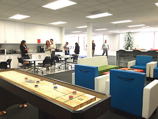 Kyriba's UTC offices feature a lounge area with shuffleboard, plenty of snacks, and an espresso machine. The company is growing its staff in San Diego and worldwide, as it brings on more clients for its treasury and risk management software. Photo courtesy of Kyriba