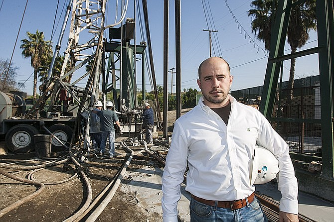 AllenCo.'s Logan Allen, pictured in 2014 at an oil field in Signal Hill near his family's well-service business. He has since left the company. (Photo by Ringo H.W. Chiu/LABJ)