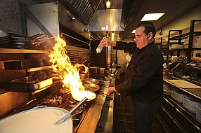 Nino Zizzo, son of Frank Busalacchi, is executive chef of all three of the Busalacchi Restaurants locations. Here, he is seen in the kitchen of Barbusa, a modern Italian food place, located in Little Italy