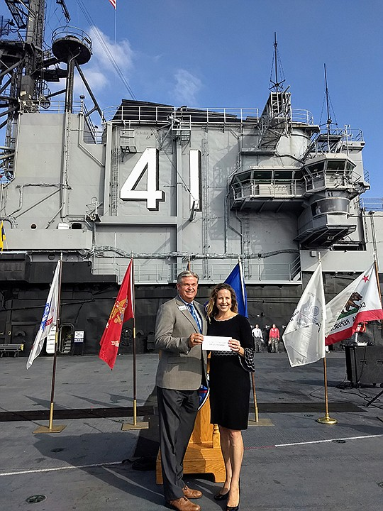 Dan Beintema, president, USS Midway Foundation and Alison Beck, chief donor relations officer, awarded $10,000 to the San Diego Center for Children. Photo courtesy of the USS Midway Foundation