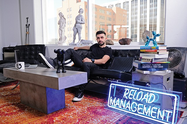 Electric: Reload Management sign lights up the brand