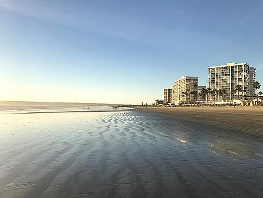The Coronado Shores high-rise condominiums beachfront just south of the Hotel del Coronado. Photo courtesy of Willis Allen Real Estate