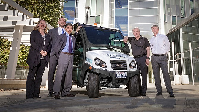 Engineering students at UC San Diego are programming self-driving mail delivery carts that use LIDAR to navigate the busy campus. Contextual Robotics Institute Director Henrik Christensen (second from right) said the project gives students skills that are in high demand. Photo courtesy of the UC San Diego Jacobs School of Engineering