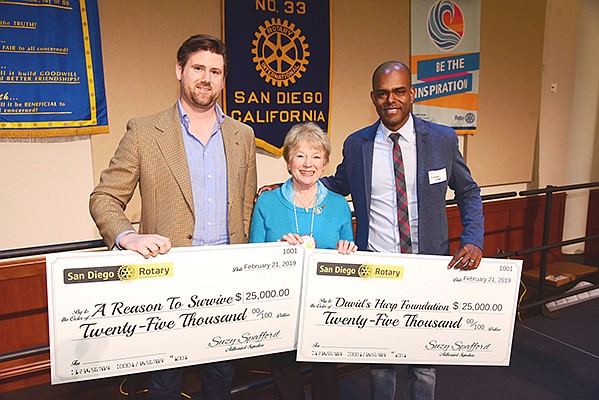 James Halliday, director at A Reason to Survive, left, Suzy Spafford, president of San Diego Rotary and Brandon Steppe, founder/executive director of David's Harp Foundation at a San Diego Rotary grant ceremony. Photo courtesy of the Rotary Club of San Diego Foundation