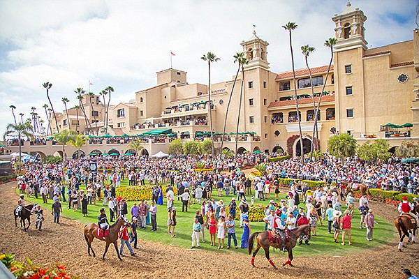 Fans are pictured at the paddock at the Del Mar Fairgrounds on a recent opening day at Del Mar, where tradition is to dress in cocktail attire and an outrageous hat. Photo courtesy of Del Mar Fairgrounds