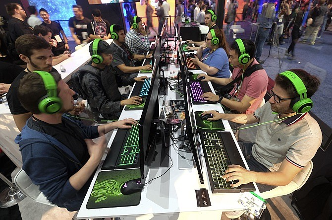 Gaming Losses: Staff cuts at video game companies come as developers turn to automation. (Photo by Ringo H.W. Chiu)