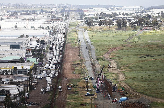 Trucks line up on the Mexican side of the border to enter the U.S. at Otay Mesa, Calif., on April 3. (Photo by Mario Tama/Getty Images)