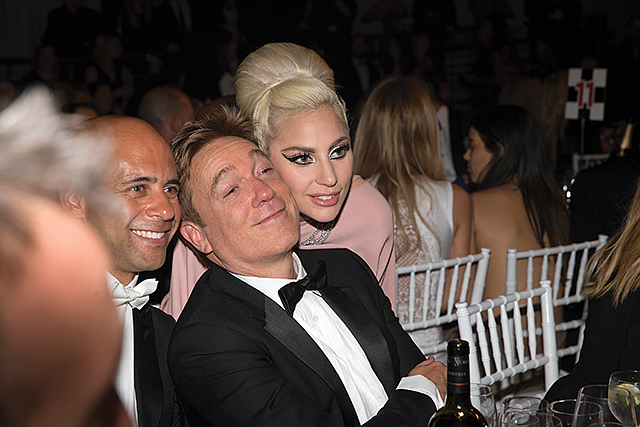 A Star is Represented: CAA Managing Partner Kevin Huvane poses with Lady Gaga at the 2015 amfAR Inspiration Gala.