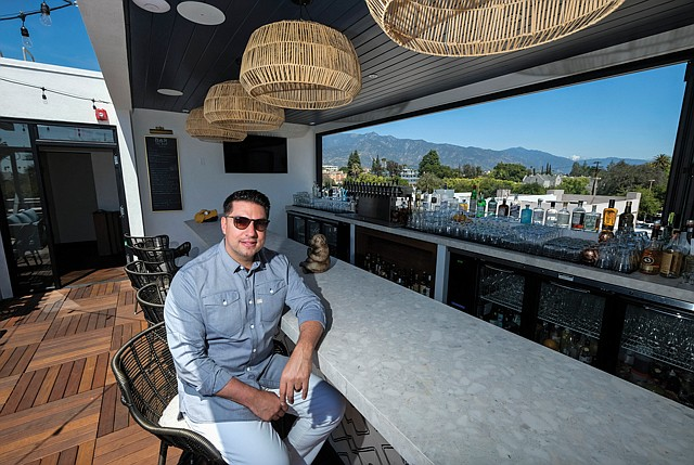 Prime Location: Jonathan Weiss takes in the view from his rooftop bar.