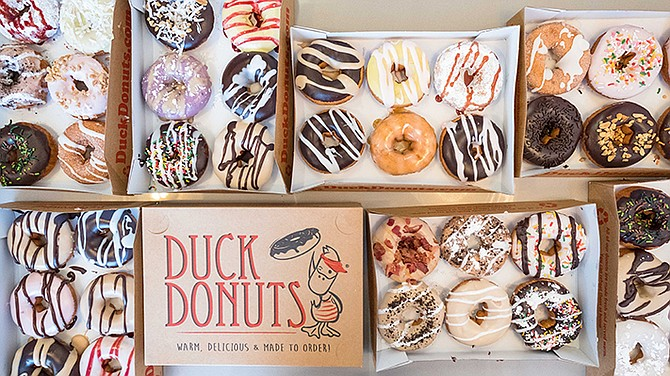 Duck Donuts offers cinnamon or powdered sugar, peanut butter or maple icing coats, toppings like chopped bacon, shredded coconut or Oreos, and a marshmallow or salted caramel drizzle, to list a few of the options. Photo courtesy of SDCM Restaurant Group