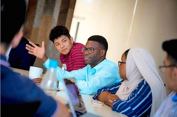 Gentry Patrick, biological sciences professor at UCSD, speaks with students in the PATHways to STEM program at the university. Photo courtesy of UC San Diego
