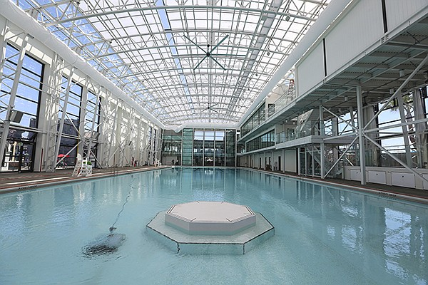 The historic Plunge swimming pool in Belmont Park has been completely rebuilt with a glass façade and a glass and aluminum retracting roof.