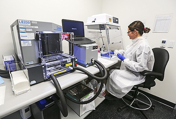 Zaira Bezares, a clinical laboratory scientist at Rady Children's Institute for Genomic Medicine, prepares reagents in the lab. Rady uses artificial intelligence to speed up genome sequencing.