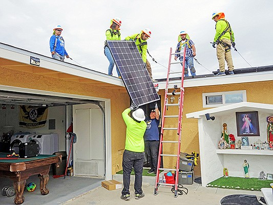 A crew from GRID Alternatives San Diego brings sustainability-focused repairs to local low-income homeowners. Photo courtesy of GRID Alternatives
