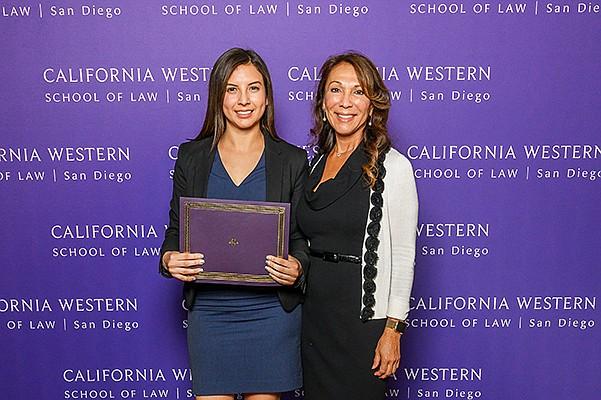 Erika Rivas, left, with Laura Padilla of Cal Western School of Law. Photo courtesy of Higgs Fletcher & Mack LLP