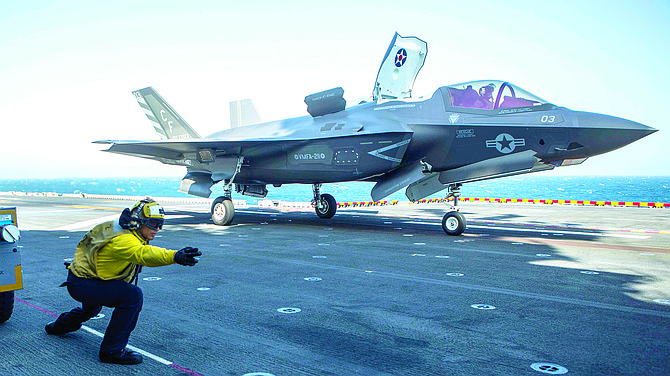 An airman launches an F-35B fighter from the deck of the USS Essex in the Indian Ocean in 2018. San Diego-based Cubic Corp. received a contract to build data links for the F-35. File photo courtesy of U.S. Marine Corps.