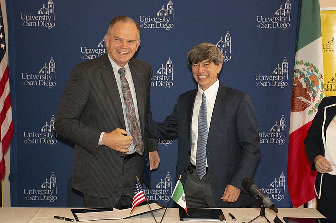 (from left to right) James T. Harris, University of San Diego's president, and Dr. Fernando Leon Garcia, president at Centro de Ensenanza Tecnica y Superior, at the program's signing ceremony early 2019. Photos courtesy of the University of San Diego.