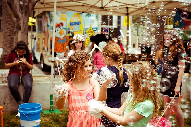 Children play with bubbles at The New Children's Museum, which just won the 2019 National Medal for Museum and Library Service. Photo courtesy of The New Children's Museum.