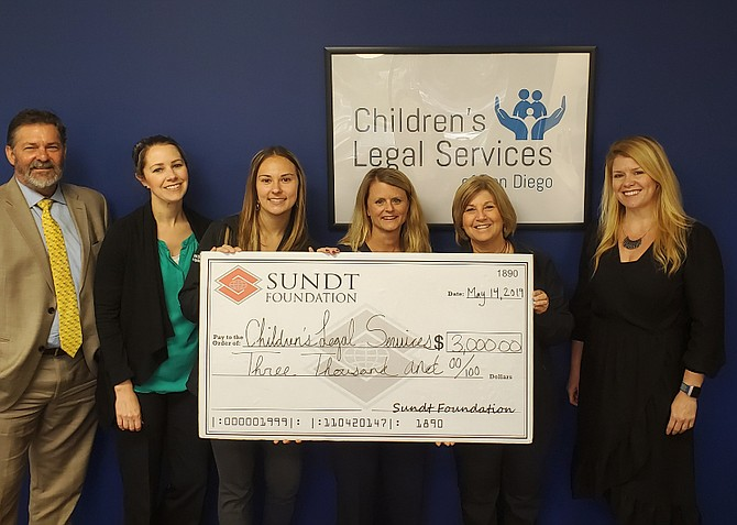 The Sundt Foundation awarded several grants to a variety of nonprofits in the community. Nonprofits are selected through an application process and reviewed by a committee of Sundt employee-owners. The foundation awarded $17,000 in grants. Above,  a check is presented to Children's Legal Services of San Diego. Photo courtesy of Sundt Foundation.