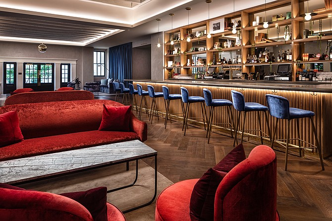 A lobby bar is one of the modern touches added in renovating the former Army-Navy YMCA to become The Guild Hotel. Photo courtesy of Robert Benson.