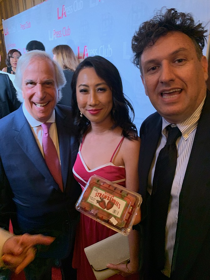 "L.A. Press Club Awards honoree Henry Winkler with Business Journal staff writer Michael Aushenker and fellow nominee Genevieve Wong, producer of ""People Magazine Investigates."""