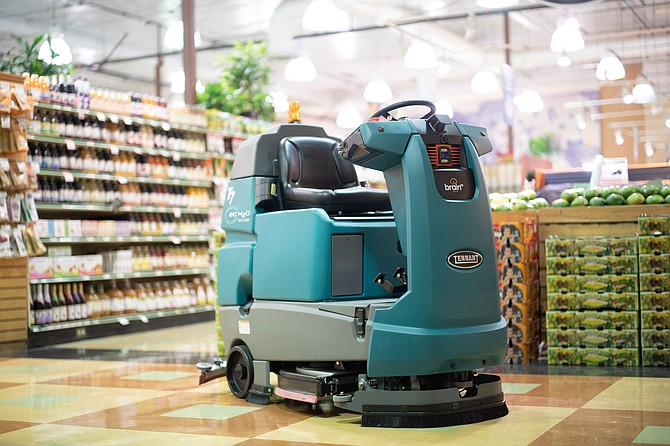 Brain Corp.'s platform allows self-driving industrial cleaning robots to navigate their surroundings. The company currently provides a fleet of cleaning robots for Walmart. Photo courtesy of X Brain Corp Robot.