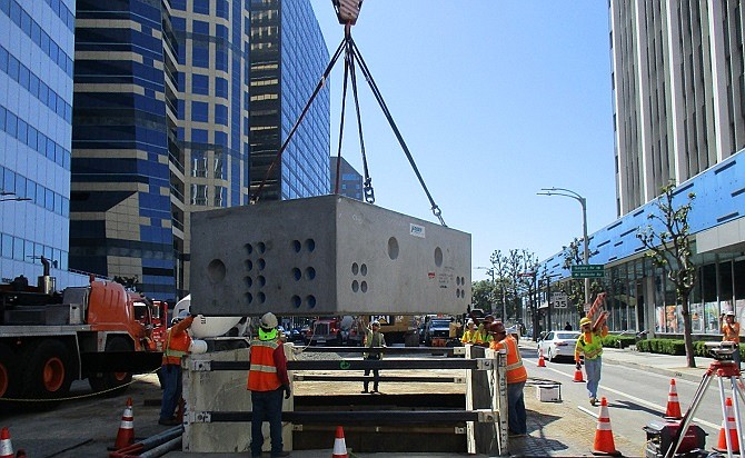Construction workers install a vault in Westwood for Metro's Purple Line Extension.