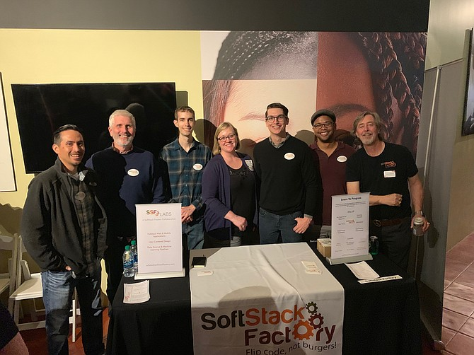 SoftStack Factory CEO Harold Gottschalk (right) and CTO Scott Holcombe (second from left) attend March Mingle with the program's graduates. Photo courtesy of SoftStack Factory.