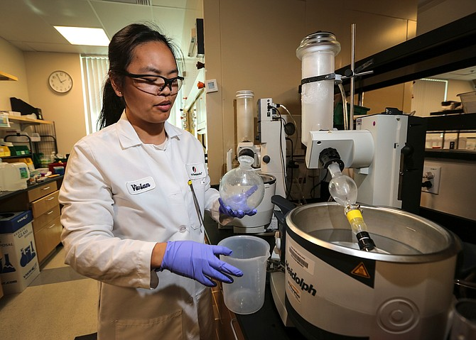 Turning Point's Therapeutics' Vivian Nguyen works in the company's La Jolla lab. Photo courtesy of Jamie Scott Lytle.