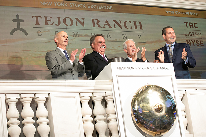 Gregory Bielli, second from left, president and chief executive of Tejon Ranch Co., joined by Douglas Yones, far right, head of exchange traded products NYSE, rings The NYSE Closing Bell.