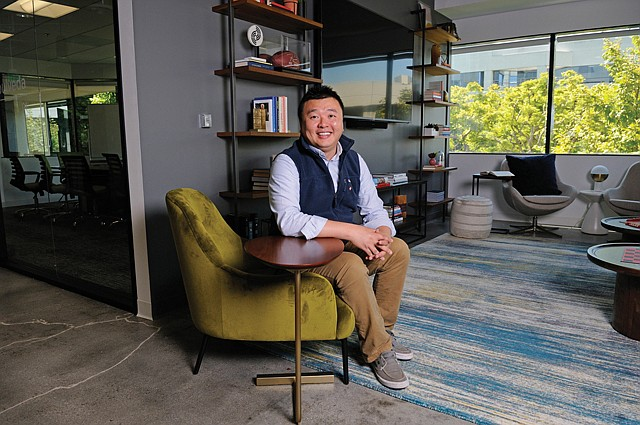 "Get Comfy: Tim Lee invites clients and visitors to the company's ""living room."""
