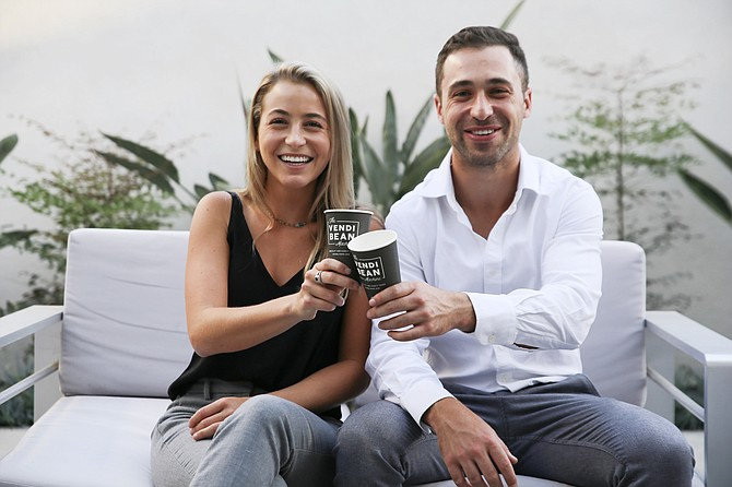 Siblings Teal Cooper (left) and Tristan Cooper (right) co-founded VendiBean in 2017. The company makes vending machines that brew espresso-based beverages at the push of a button. Photo courtesy of VendiBean.