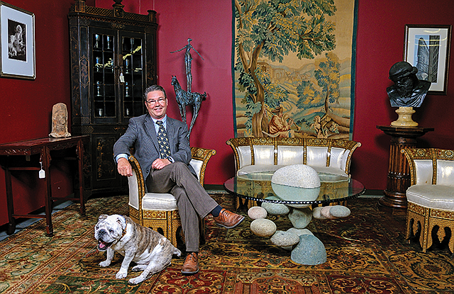 Dog Days: Andrew Jones, with Archie, says this is a great time to buy antiques.