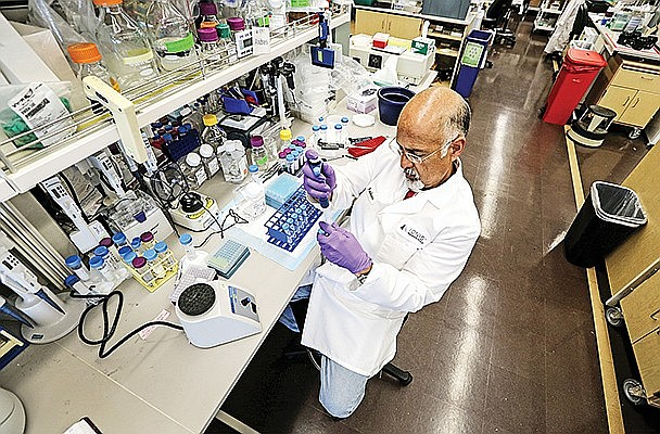Research Assistant Andres Berdeja works at one of the Ionis labs in Carlsbad. Photo of Jamie Scott Lytle.