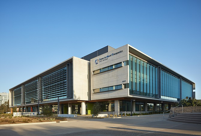 The inside and outside of the Center for Novel Therapeutics, which combines doctors and researchers at Moores Cancer Center with private sector companies. Photos courtesy of BioMed Realty.