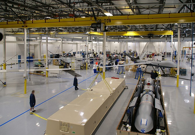 Predator family aircraft are seen on the production floor at General Atomics Aeronautical Systems Inc. in an undated photo. GA-ASI, which provided the photograph, blurred the faces of the employees. Photo courtesy of General Atomics Aeronautical Systems Inc.