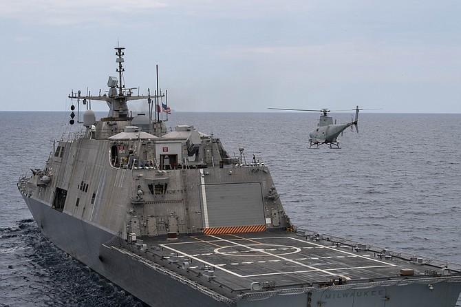 An MQ-8B Fire Scout helicopter hovers over the Littoral Combat Ship USS Milwaukee in June in the Atlantic Ocean. Photo courtesy of U.S. Navy.