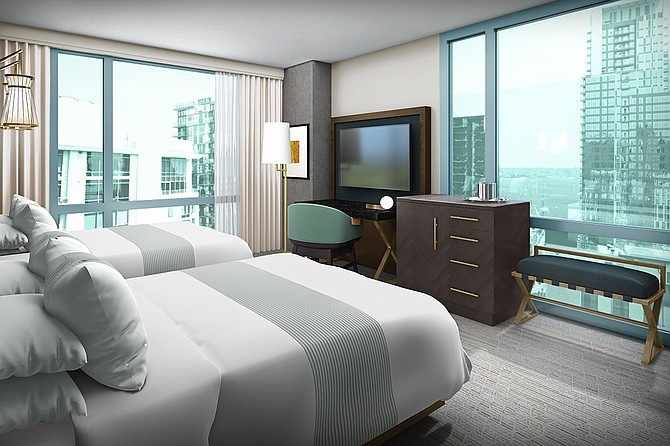 Manchette Studio used a monochromatic blue palette with hints of gold and copper for the interior design of the Carte Hotel, according to the company. Rendering courtesy of Manchette Studio, LLC.