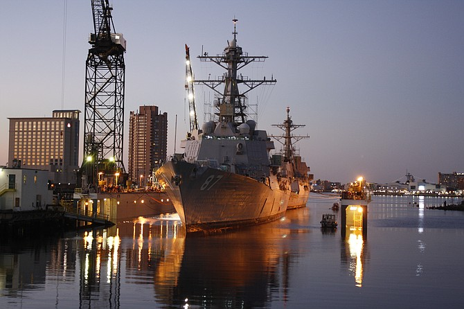 Two destroyers rest in BAE Systems' submerged dry dock in Virginia prior to repair work. Photo courtesy of BAE Systems Ship Repair.