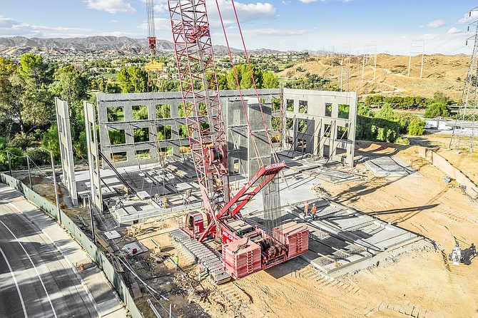 Crane stands up wall at 27335 Tourney Road in Valencia.