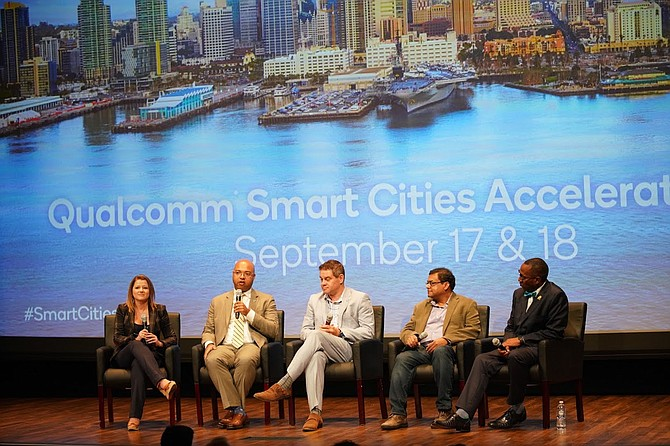 Erik Caldwell, deputy chief operating officer for the city of San Diego (second from left), and David Graham, chief innovation officer for the city of Carlsbad (center), shared the biggest opportunities and obstacles they see in smart city efforts. Photos courtesy of Qualcomm.