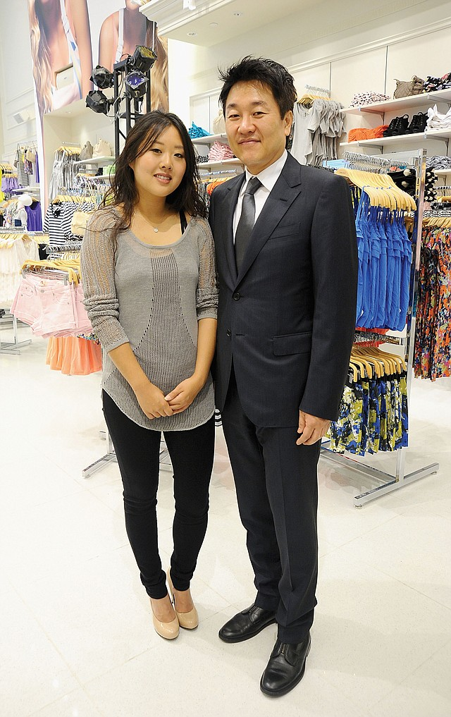 Executive Vice President Linda Chang, with her father, Forever 21 co-founder Do Won Chang