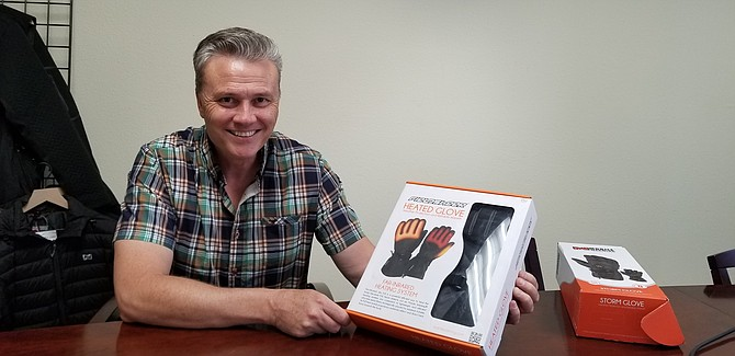 KC Bean, CEO of Tech Gear 5.7 (Mobile Warming's parent company) shows the heated gloves that are part of a wearables line. Photo courtesy of Tech Gear 5.7.