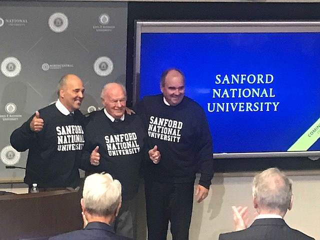 Michael Cunningham, left, T. Denny Sanford and David Andrews announce the $350 million gift to National University. The university will change its name to Sanford National University in 2020. Photo courtesy of National University.