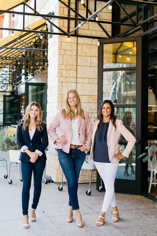 Carrie Bobb, center, formed her own commercial real estate company with Claire Plecha, left, and Emily Jones, right. Photo by Halli Makenna.