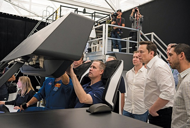Lift Off: NASA Administrator Jim Bridenstine, center, participates in a Crew Dragon flight simulation Oct. 10 at SpaceX headquarters in Hawthorne.