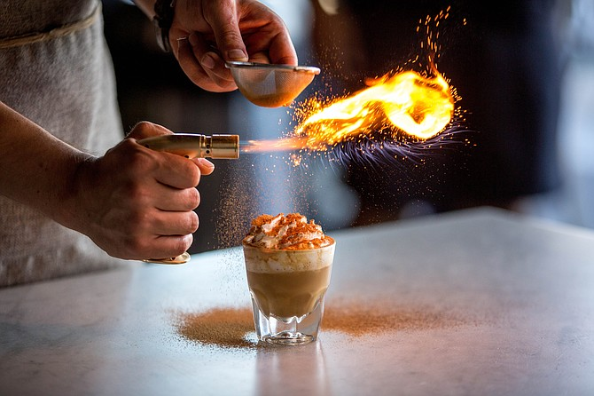Mostra Coffee offers a latte made with coconut infused milk, espresso, a dash of vanilla and topped with caramelized turbinado sugar and toasted coconut powder. Photo courtesy of Monstra Coffee.