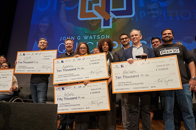 Winners at this year's John G. Watson Quick Pitch competition took home a combined total of $75,000. From left to right: Third-place winner Devon Cayer, CEO of 1859 Inc.; first-place and audience choice winner Martha Montoya, CEO of AgTools; second-place winner Jay Comier, CEO of Eyedaptic. Photo courtesy of Drew McGill.